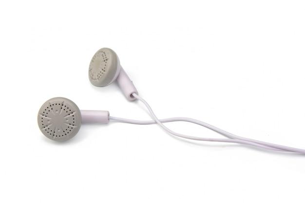 Witte oortelefoons die op witte achtergrond met het knippen van weg worden geïsoleerd Premium Foto