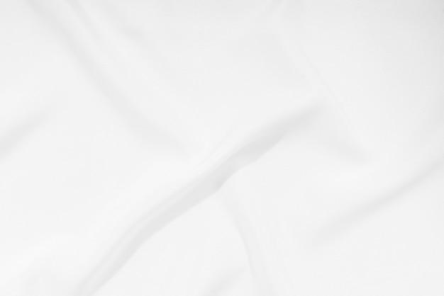 Witte stof, de textuurachtergrond van de doekgolf, lege ruimte. / zacht beeld. Premium Foto