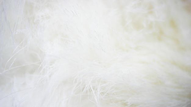 Witte stoffen achtergrond, witte doek en zachte witte vacht Premium Foto