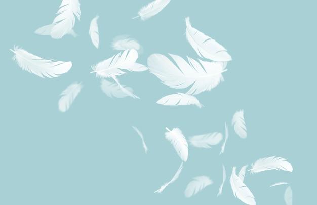 Witte veren zwevend in de lucht op blauwe pastel achtergrond Premium Foto