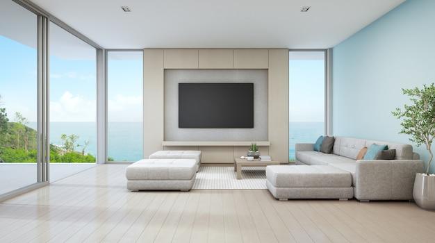 Woonkamer met zeezicht van luxe strandhuis met glazen deur en houten ...