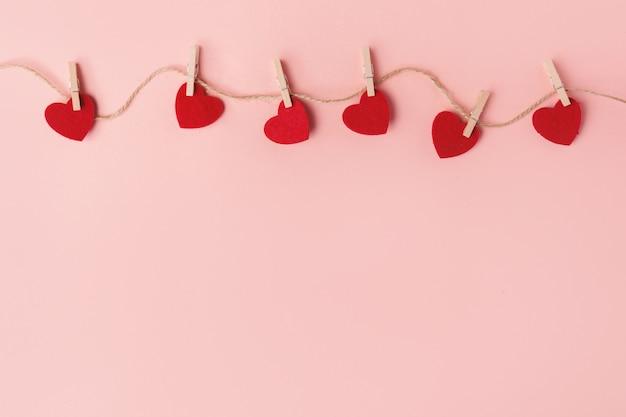 Zachte valentijnsdag harten op roze Gratis Foto