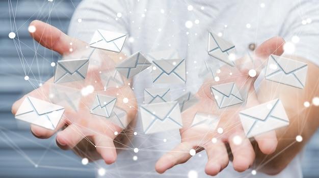 Zakenman die 3d teruggevend vliegend e-mailpictogram in zijn hand houden Premium Foto