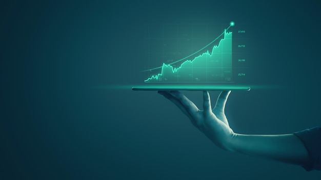 Zakenman die tablet houdt en holografische grafieken en beursstatistieken toont, wint winst. Premium Foto