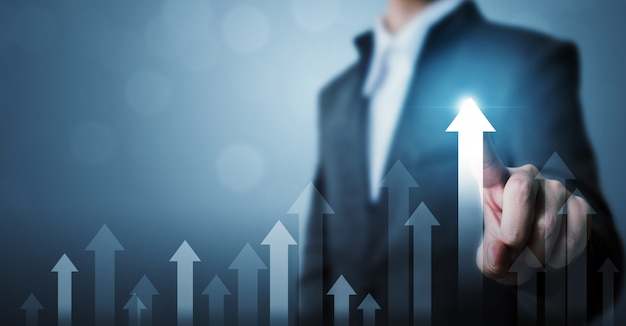 Zakenman wijzende pijl grafiek corporate toekomstige groei plan en verhoging percentage Premium Foto