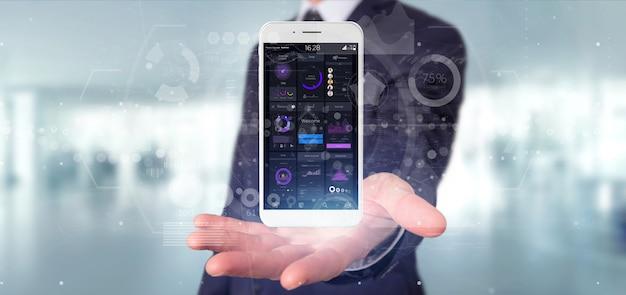 Zakenmanholding smartphone met gebruikersinterfacegegevens over het scherm Premium Foto