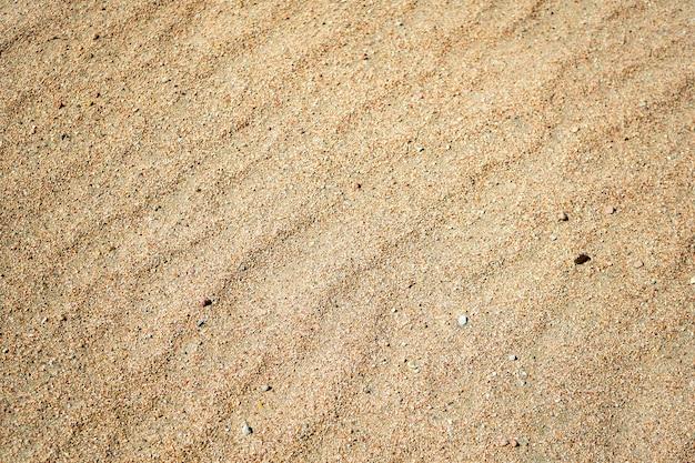 Zand op het strand op zonnige dag Premium Foto