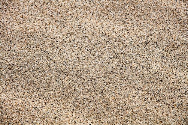 Zand textuur van een strand close-up Premium Foto