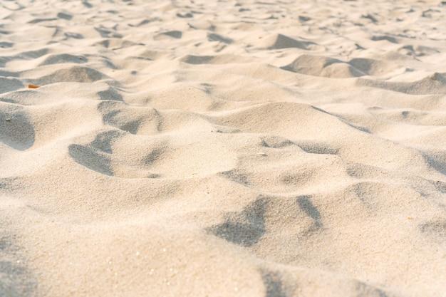 Zand textuur. zandstrand voor achtergrond. sluit omhoog, kopieer ruimte. Premium Foto