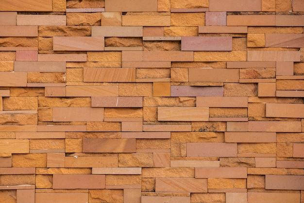 Zandsteenstenen naadloos van muur. patroon continue replicatie voor textuur en achtergrond Premium Foto