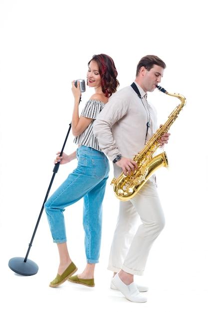 Zangeres en saxofonist Premium Foto