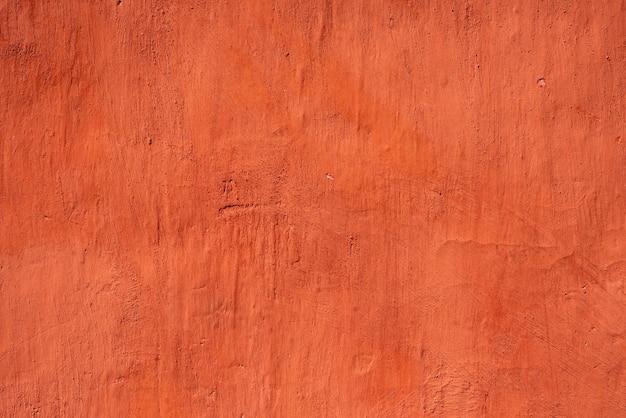 Zeer gedetailleerde rode kleur gepleisterde muur achtergrond Premium Foto