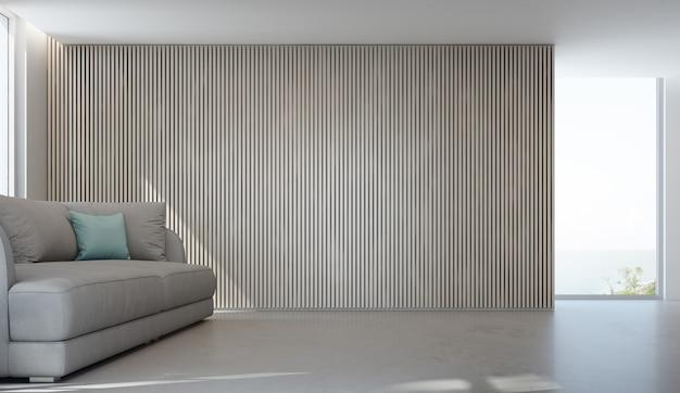 Zeezicht woonkamer van luxe zomer strandhuis met glazen raam en betonnen vloer. Premium Foto