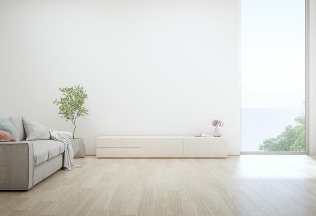 Zeezicht woonkamer van luxe zomer strandhuis met tv-standaard en houten kast. Premium Foto