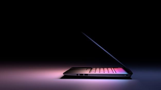Zijaanzicht van laptop-pc met kleurlicht op donker. technologie gaming concept. Premium Foto