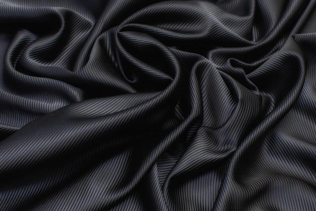 Zijden stof cadi zwart in de artistieke lay-out Premium Foto