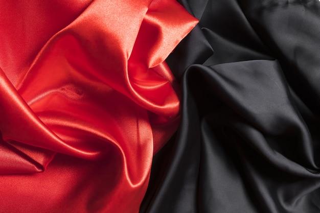 Zijden stof rood en zwart materiaal voor huisdecoratie Premium Foto