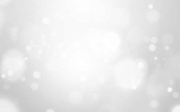 Zilveren lichte en witte kerstmisachtergrond met onduidelijk beeld bokeh mooie textuur. glow schittering Premium Foto