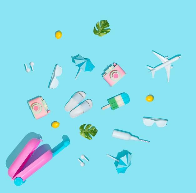 Zomervakantie concept met koffer en strandartikelen op pastelblauw. Premium Foto