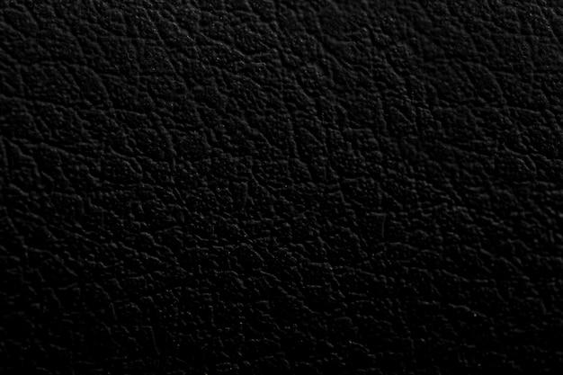 Zwart lederen textuur achtergrond oppervlak Premium Foto