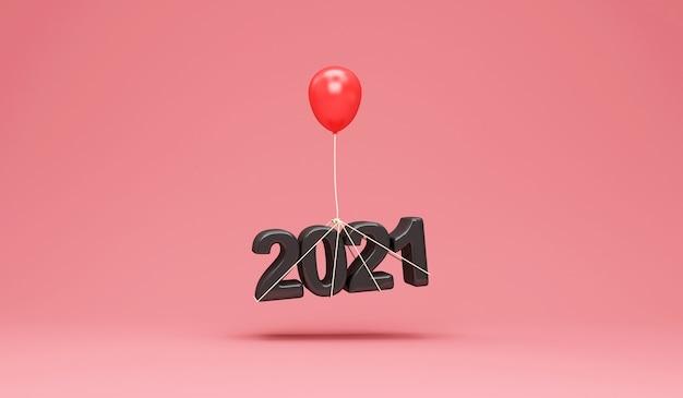Zwart nieuwjaarssymbool 2021 met rode ballon op roze studioachtergrond Premium Foto