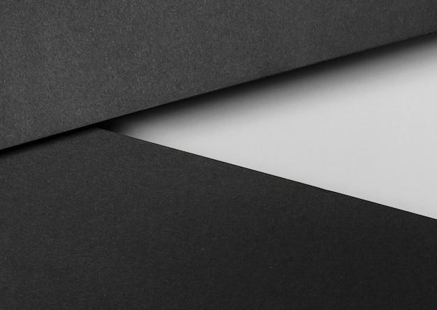 Zwart-wit lagen papier bovenaanzicht Gratis Foto