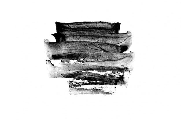 Zwarte abstracte penseelstreken en spatten van verf op papier. grunge kunst kalligrafie achtergrond Premium Foto