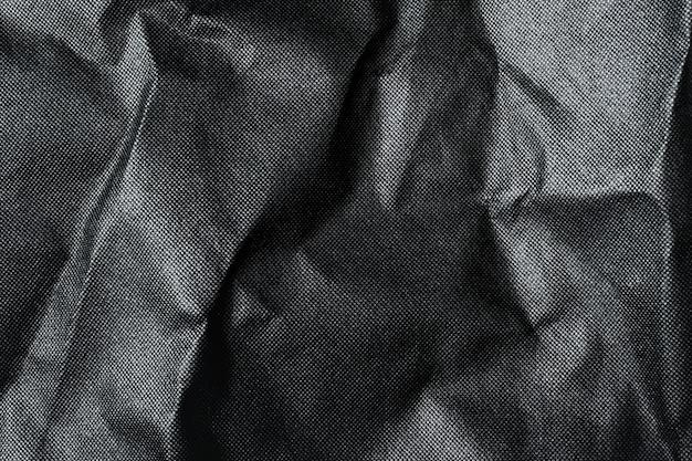 Zwarte achtergrond luxe doek golf textuur. Premium Foto