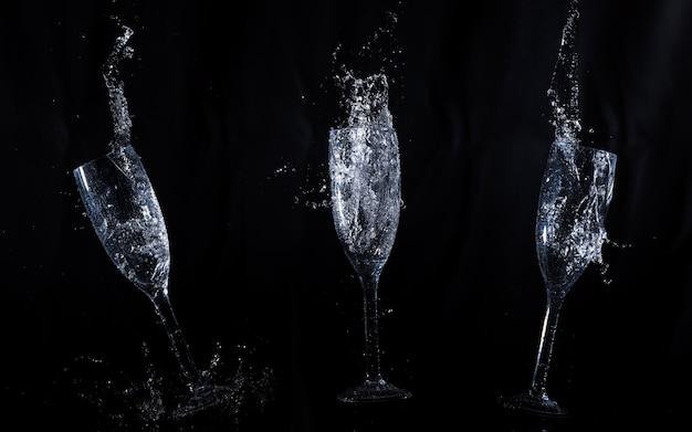 Zwarte achtergrond met kristallen glazen in beweging Gratis Foto