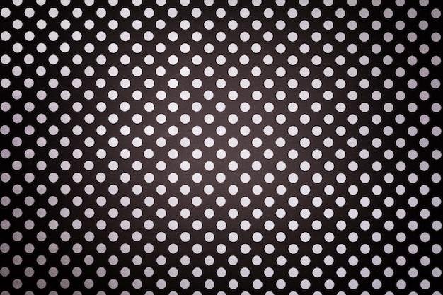Zwarte achtergrond van inpakpapier met een patroon van witte stipclose-up. Premium Foto