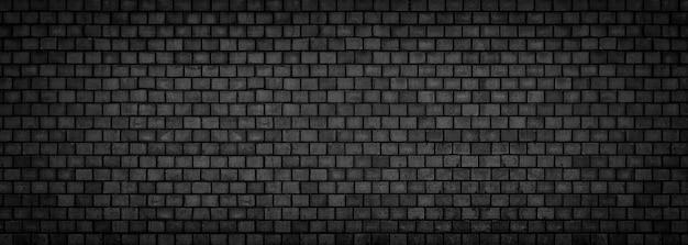 Zwarte bakstenen muur, brede panoramische steenoppervlaktetextuur Premium Foto
