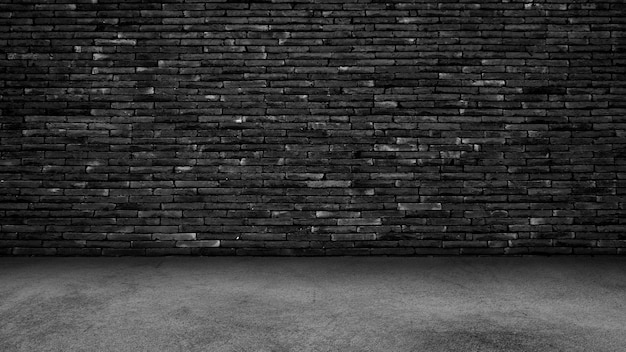 Zwarte cementvloer en muurachtergrond, duisternis Premium Foto