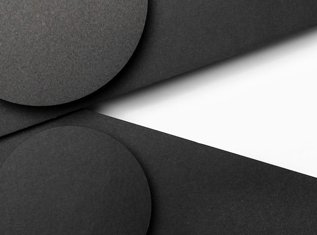 Zwarte cirkelvormige lagen papier Gratis Foto