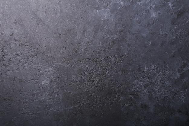 Zwarte donkere steen achtergrondtextuurachtergrond exemplaarruimte Premium Foto