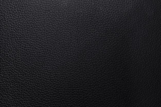 Zwarte leder texture achtergrond. closeup wallet abstract materiaal patroon of luxe botste dierenhuid. Premium Foto