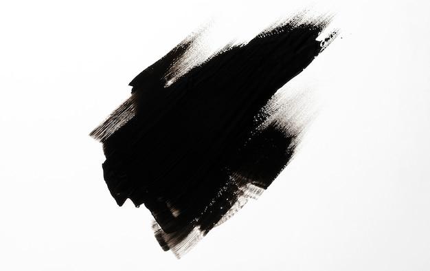Zwarte penseelstreek op witte achtergrond Premium Foto