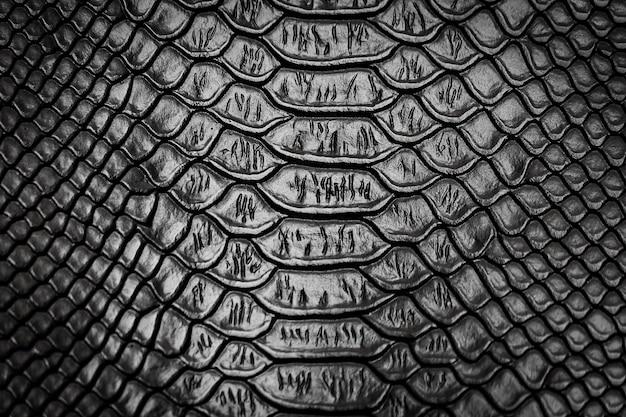 Zwarte slang patroon textuur achtergrond Premium Foto