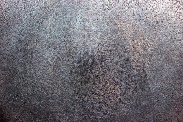 Zwarte staalplaat textuur, donkere achtergrond van versleten metaal Premium Foto