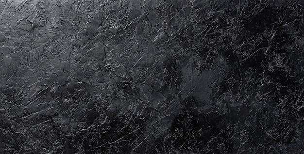 Zwarte steentextuur, donkere lei, bovenaanzicht Premium Foto