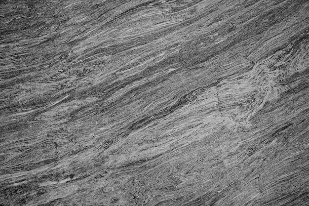 Zwarte stenen vloer of steen textuur kan worden gebruikt als achtergrond Premium Foto