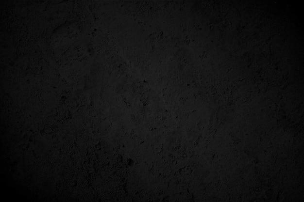 Zwarte textuur met hoge resolutie, natuurlijke zwarte stenen muur achtergrond Premium Foto