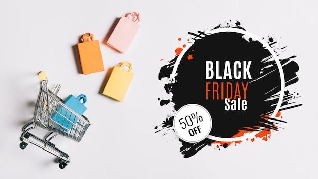 Zwarte vrijdag concept winkelwagen Gratis Foto