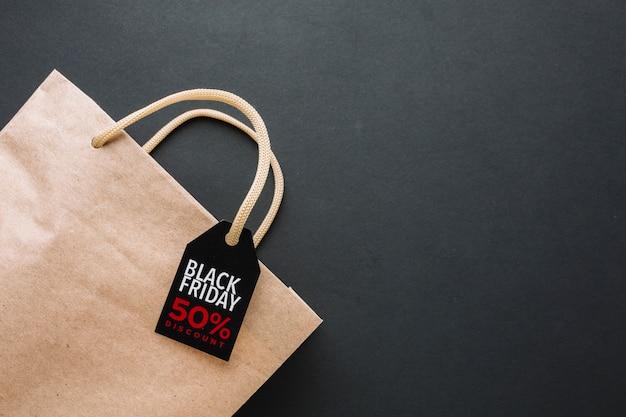 Zwarte vrijdag-kortingstas in platte leg Gratis Foto