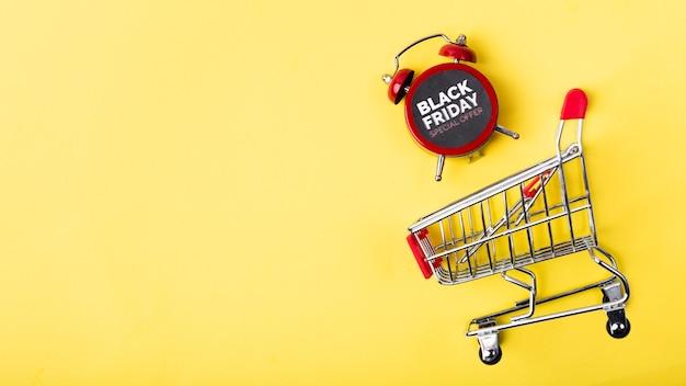 Zwarte vrijdagwekker in winkelwagen Gratis Foto