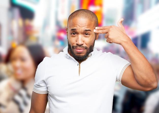 Zwarte zakenman droevige uitdrukking Gratis Foto