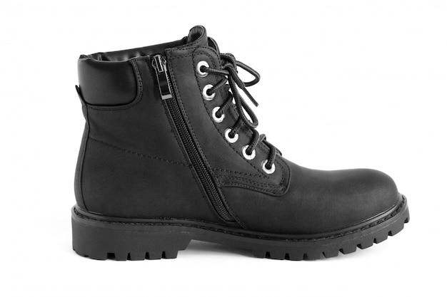 Zwarte zware unisex-laarzen die op wit, schoenen voor de herfstwinterseizoen worden geïsoleerd Premium Foto