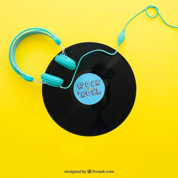 Vinyl mockup met koptelefoon Gratis Psd