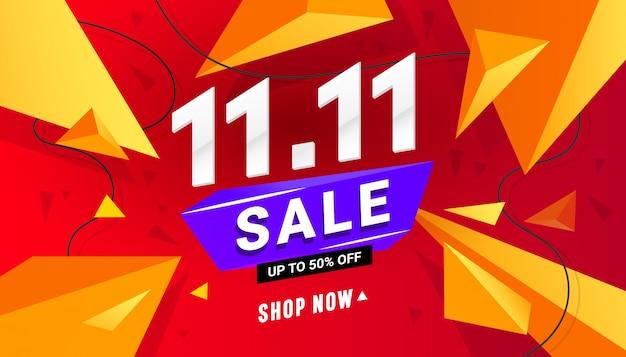 11.11 verkoop banner sjabloonontwerp met veelhoekige vormen op een rode achtergrond voor speciale aanbieding en korting Premium Vector