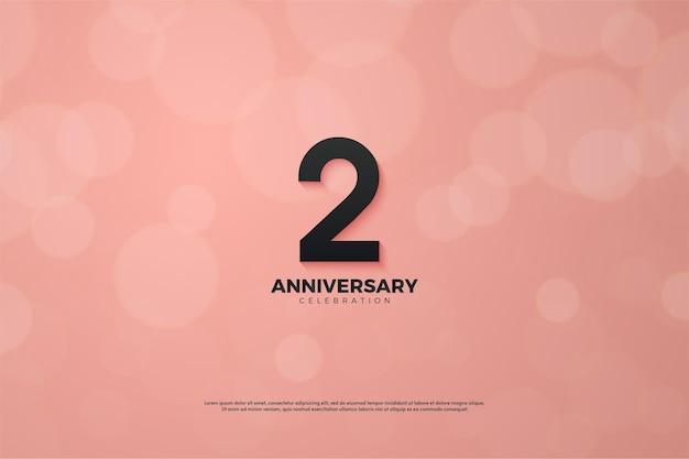 2e verjaardag met zwarte nummerillustratie op roze achtergrond met bokeh-effect. Premium Vector