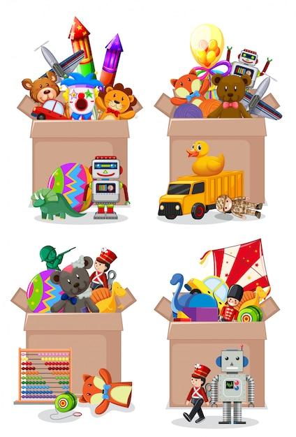 Aantal dozen vol speelgoed op wit Gratis Vector